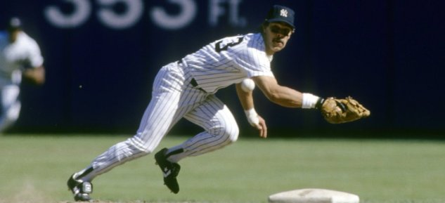 BRONX, NY - CIRCA 1980's: First baseman Don Mattingly #23 of the New York Yankees ready for action dives for a ball hit down the firstbase line during a mid circa 1980's Major League baseball game at Yankee Stadium in Bronx, New York. Mattingly played for the Yankees from 1982-95. (Photo by Focus on Sport/Getty Images)