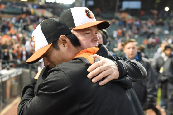 BALTIMORE, MD - OCTOBER 04: Manager Buck Showalter #26 of the Baltimore Orioles hugs Wei-Yin Chen #16 after a baseball game against the New York Yankees at Oriole Park at Camden Yards on October 4, 2015 in Baltimore, Maryland. The Orioles won 9-4. (Photo by Mitchell Layton/Getty Images)